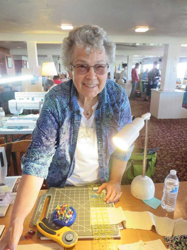Barb Draper working on a quilt